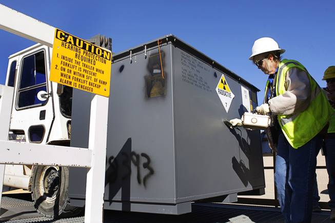 Pam Salvato, a radiation control technician, surveys a container for contamination in the Area 5 Radioactive Waste Management Site of the Nevada National Security Site (N2S2), previously the Nevada Test Site, about 65 miles northwest of Las Vegas, on Feb. 1, 2011.