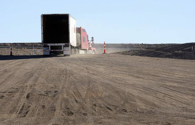 A semi tractor-trailer leaves after waste was off loaded in the Area 5 Radioactive Waste Management Site of the Nevada National Security Site (N2S2), previously the Nevada Test Site, about 65 miles northwest of Las Vegas on Feb. 1, 2011. The waste came from Oak Ridge, Tenn, about 2,200 miles away.
