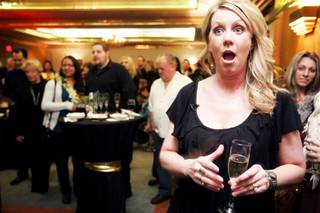 Designer Tina Enard of Reno-based Urban Design Studio reacts as she is announced the winner of the Design a Suite contest for her suite called