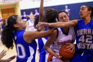 Megan Carter of Bishop Gorman battles for the rebound against Sierra Vista during their girls basketball game at Bishop Gorman High School Thursday, February 3, 2011.   Gorman game out on top 65-40.