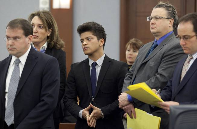 Peter Hernandez, aka Bruno Mars, center, appears in court to waive an evidentiary hearing for a felony cocaine possession charge and receive a date in state court for a plea, Friday, Feb. 4, 2011, in Las Vegas. Mars was accompanied by his defense attorneys Blair Berk, second from left, David Chesnoff, second from right and Richard Schonfeld, right. Deputy district attorney David Schubert, left, looked on.