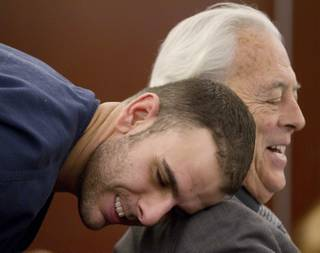 Anthony M. Carleo, left, talks with his attorney William Terry before the start of court, Monday, Feb. 7, 2011 in Las Vegas. Carleo made his first court appearance since his arrest in a dramatic heist that authorities say netted $1.5 million in casino chips from the Bellagio resort on the Las Vegas Strip. The twenty-nine-year-old was not asked to enter a plea Monday to armed robbery, assault and burglary charges in the Dec. 14 heist. A judge scheduled another hearing for Feb. 23.
