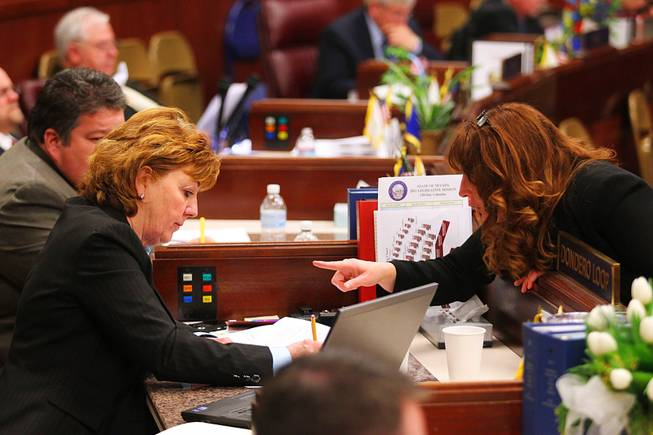 Assemblywoman Marilyn Kirkpatrick talks to Assemblywoman Marilyn Dondero Loop during the first day of the 2011 legislative session Monday, February 7, 2011 in Carson City.