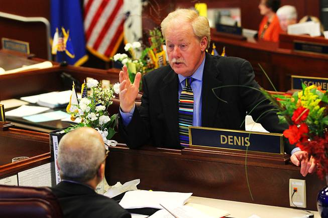 Senator Michael Schneider speaks to Senator Mo Denis during the first day of the 2011 legislative session Monday, February 7, 2011 in Carson City.