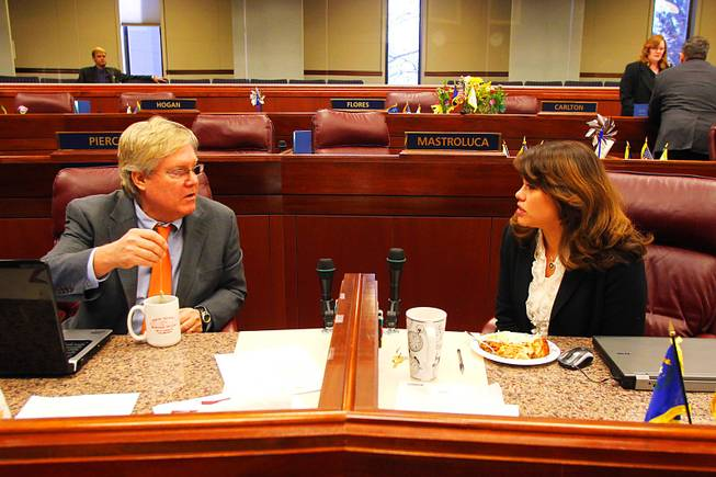Assembly members Tick Segerblom and Teresa Benitez-Thompson talk before an Assembly meeting on the third day of the 2011 legislative session Wednesday, February 9, 2011 in Carson City.