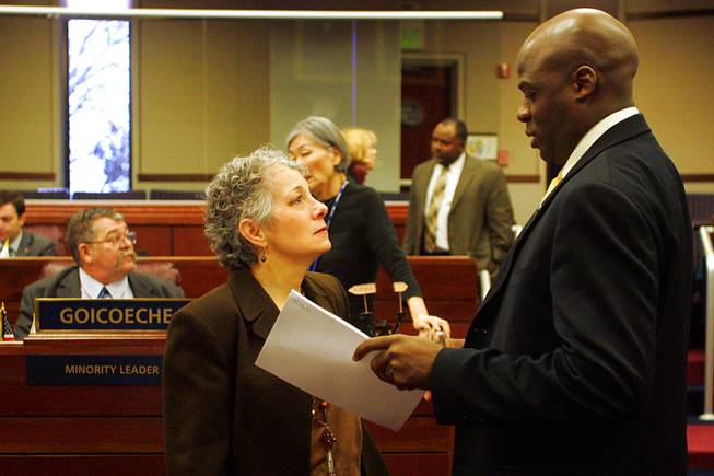 Assembly members Peggy Pierce and Kelvin Atkinson talk before a meeting of the Assembly on the third day of the 2011 legislative session Wednesday, February 9, 2011 in Carson City.
