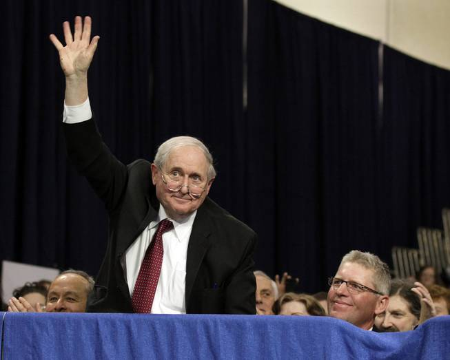 Sen. Carl Levin, D-Mich., waves as he is acknowledged by President Barack Obama at Northern Michigan University, Thursday, Feb. 10, 2011, in Marquette, Mich. Seated at right is Marquette, Mich., Mayor John Kivela.  (AP Photo/Carolyn Kaster)