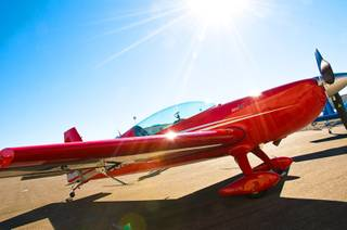 The Extra330LC aerobatic airplane, used by Air Combat Ace, sits on the tarmac before flight time Feb. 10, 2011.
