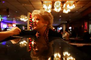 Las Vegas mayor candidate Carolyn Goodman schmoozes with a potential voter during a campaign event this month at El Cortez.