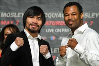 Boxers Manny Pacquiao of the Philippines and Shane Mosley of Pomona, Calif. pose during a news conference at the MGM Grand Garden Arena Saturday, February 12, 2011. The fighters are promoting their May 7 welterweight fight at the arena.