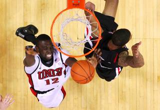 UNLV forward Brice Massamba puts up a shot against San Diego State forward Malcolm Thomas during their game Saturday, February 12, 2011 at the Thomas & Mack Center. San Diego State won 63-57.