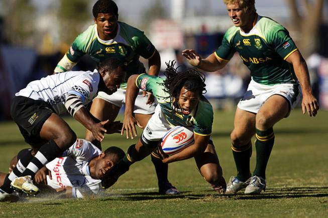 Cecil Afrika of South Africa is tackled during the final match of the 2011 USA Sevens Rugby World Series at Sam Boyd Stadium Sunday, February 13, 2011. South Africa beat Fiji for the championship 24-14.