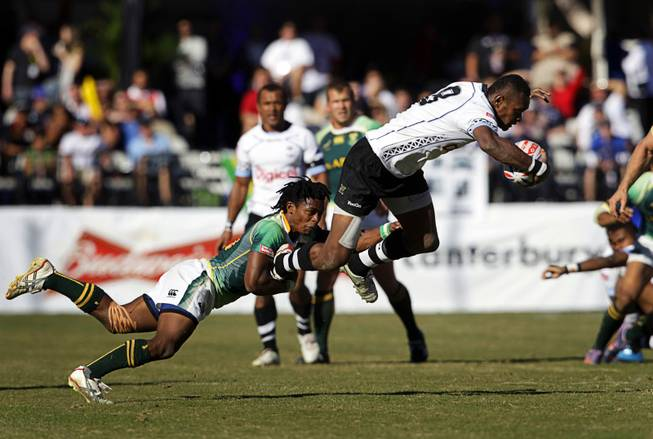 Branco du Preez (#10) of South Africa tackles Mitieli Nacagilevu (#8) of Fiji during the final match of the 2011 USA Sevens Rugby World Series at Sam Boyd Stadium Sunday, February 13, 2011. South Africa beat Fiji for the championship 24-14.