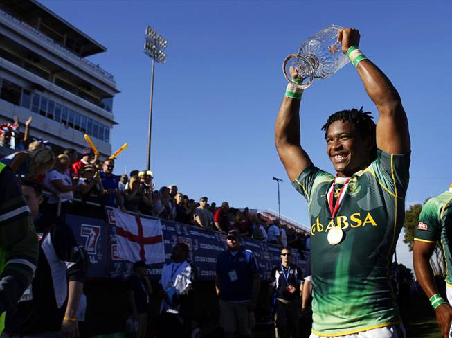 Branco du Preez of South Africa holds up the trophy after beating Fiji in the final match of the 2011 USA Sevens Rugby World Series at Sam Boyd Stadium Sunday, February 13, 2011.