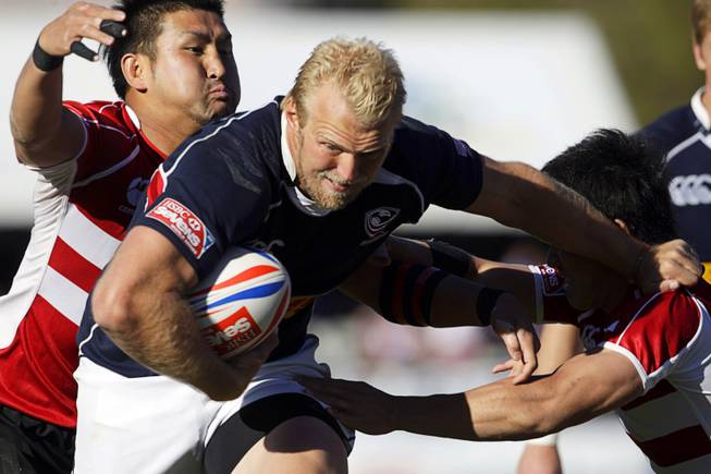 Matt Hawkins of the USA Eagles muscles his way through Japanese defenders during the 2011 USA Sevens Rugby World Series at Sam Boyd Stadium on Sunday, Feb. 13, 2011. The USA Eagles won 27-7 over Uruguay, then beat Japan 19-12 to win the Shield final.
