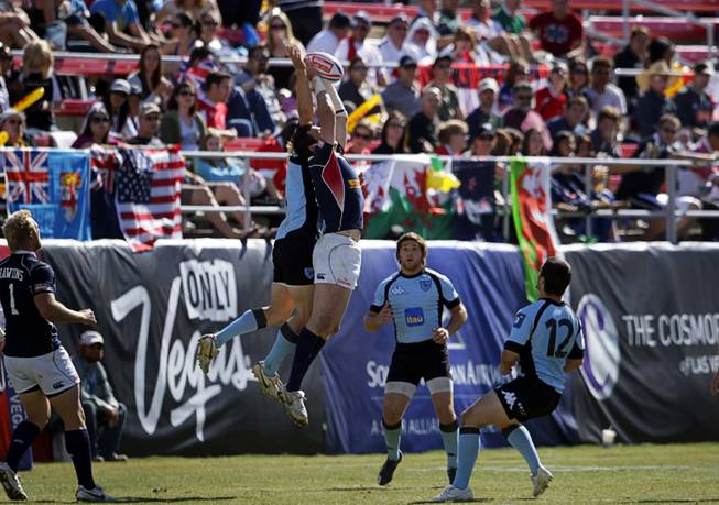 Zach Test, center, (#5) of the USA catches a ball in a game against Uruguay during the 2011 USA Sevens Rugby World Series at Sam Boyd Stadium Sunday, February 13, 2011. The USA team won a 27-7  victory over Uruguay, then beat Japan 19-12 to win the Shield final.