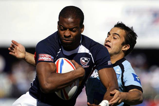 Miles Craigwell (#7) of the USA carries the ball against Uruguay during the 2011 USA Sevens Rugby World Series at Sam Boyd Stadium Sunday, February 13, 2011. The USA team won a 27-7  victory over Uruguay, then beat Japan 19-12 to win the Shield final.