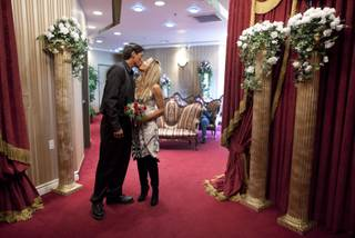 Christopher Pruett, left, and Cindy Zuniga of Honolulu, Hawaii, kiss after being pronounced man and wife at the Little White Wedding Chapel, Monday, Feb. 14, 2011 in Las Vegas.