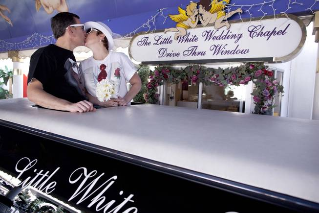 Richard, left, and Lisa Dishong, of Harrisburg, Penn., kiss while waiting to be married at the drive thru window of the Little White Wedding Chapel, Monday, Feb. 14, 2011 in Las Vegas.