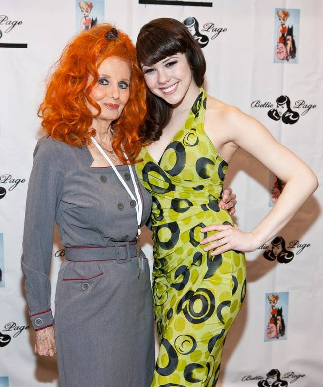 Tempest Storm and Claire Sinclair at the Bettie Page Clothing Booth at MAGIC at the Las Vegas Convention Center on Feb. 14, 2011.