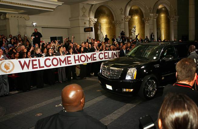 Employees hold a welcome banner as Celine Dion arrives at Caesars Palace in Las Vegas on Feb. 16, 2011. The singer begins a new series of shows at The Colosseum at Caesars Palace on March 15.