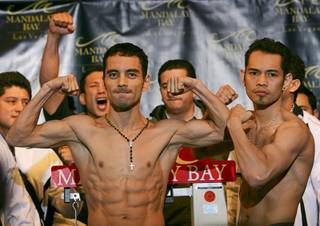 WBC/WBO bantamweight champion Fernando Montiel of Mexico and Nonito Donaire of the Philippines pose during an official weigh-in Friday at Mandalay Bay. Montiel will defend his titles against Donaire at the Mandalay Bay Events Center on Saturday.
