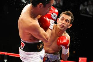 Nonito Donaire of the Philippines (R) punches at WBC/WBO bantamweight champion Fernando Montiel of Mexico during their title fight Saturday at the Mandalay Bay Events Center.