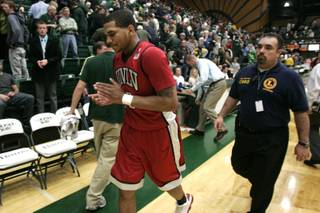 UNLV guard Anthony Marshall quietly claps to himself while leaving the court after the Rebels beat Colorado State in their Mountain West Conference game 68-61 at Moby Arena Saturday, February 19, 2011 in Fort Collins.