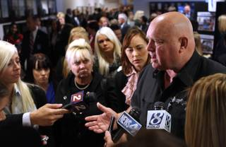 Moonlite Bunny Ranch brothel owner Dennis Hof answers the media questions on Tuesday, Feb. 22, 2011, at the Legislature in Carson City following a speech from U.S. Senate Majority Leader Harry Reid in which he proposed banning legal prostitution in the state.