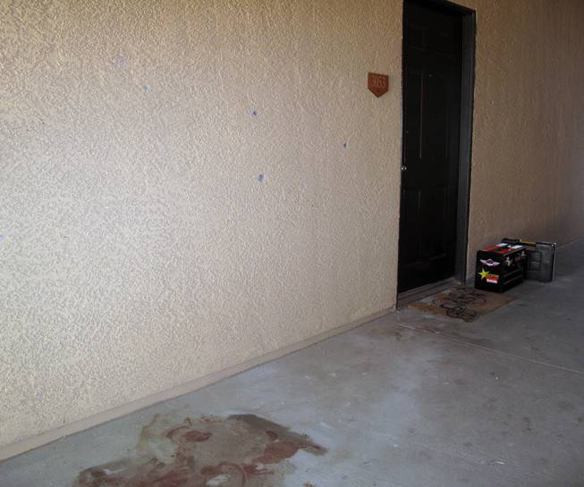 Bullet holes and a blood stain are visible on the third floor of a building within the Broadstone Montecite Apartments complex on Grand Teton Drive, where a gunman was shot and killed by Metro Police after firing at officers.