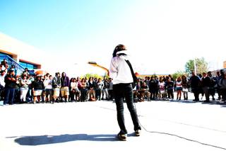 Senior, Marisa Denton, plays the guitar in front of her classmates during the schools courtyard during the Desert Pine High School's talent search Thursday, February 24, 2011 in Las Vegas.