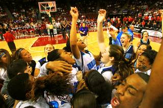 The Centennial girls basketball team and fans celebrate their 71-65 win over Liberty in the state championship basketball game Friday, February 25, 2011 at the Orleans Arena.