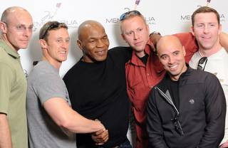 Mike Tyson with fans at Memorabilia International.