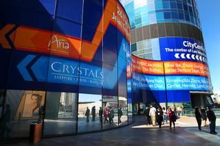 A building wrap, starting at the base of the Harmon, points pedestrians to CityCenter and the Crystals mall Monday, Feb. 28, 2011.