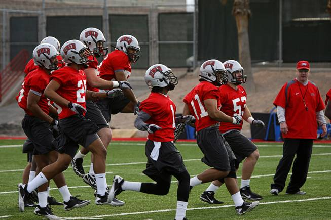 UNLV football players run during the first day of Spring practice at Rebel Park on the UNLV campus Monday, February 28, 2011.