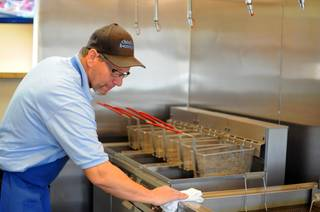 Co-owner Mark Goldenberg cleans the deep fryers on Tuesday, March 1, 2011, at his new Parisian-Texan eatery, Chicks and Benny's, located in Henderson.
