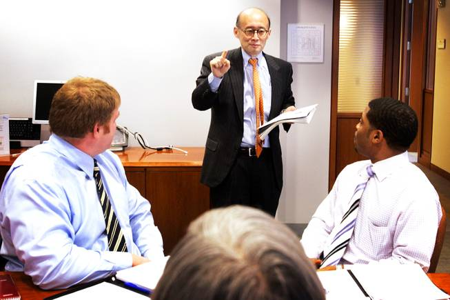 Dr. Tom Lee, the CEO of Partners Community HealthCare Inc., leads a meeting in the Prudential Building in Boston on Wednesday, March 2, 2011.