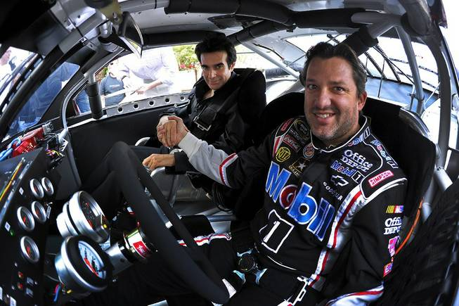 NASCAR driver Tony Stewart, David Copperfield and the street-legal Mobil 1 Chevy stock car on March 2, 2011.