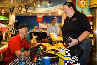 NASCAR driver Kyle Busch greets fan Sue Parzych of Ann Arbor, Mich. at the M&M's World Las Vegas store on the Las Vegas Strip Thursday, March 3, 2011.
