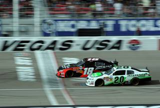 Kyle Busch (18) battles Denny Hamlin for the lead of the NASCAR Nationwide Series Samis Town 300 at the Las Vegas Motor Speedway on Saturday, March 05, 2011.