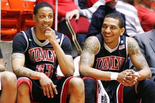 UNLV guards Tre'Von Willis and Anthony Marshall smile on the bench late in the game as the Runnin' Rebels cruised past Utah 78-58 during their Mountain West Conference season finale Saturday, March 5, 2011 at the Huntsman Center in Salt Lake City.