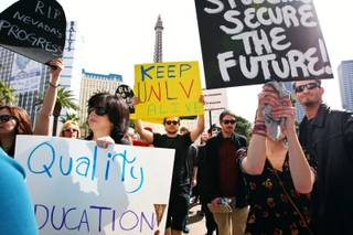 Protesters make their way along Las Vegas Boulevard during a protest against education budget cuts Sunday, March 6, in front of the Bellagio on the Las Vegas Strip.