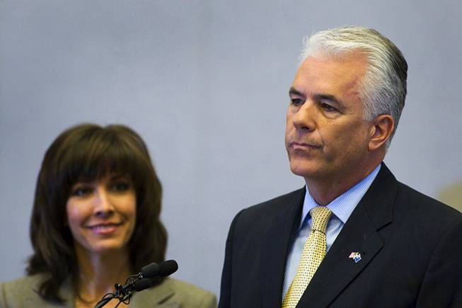 U.S. Sen. John Ensign (R-NV) announces he will not seek another term in 2012 during a news conference at the Lloyd George Federal Building in Las Vegas, Nevada Monday, March 7, 2011.  Ensign's wife Darlene is at left. STEVE MARCUS / LAS VEGAS SUN