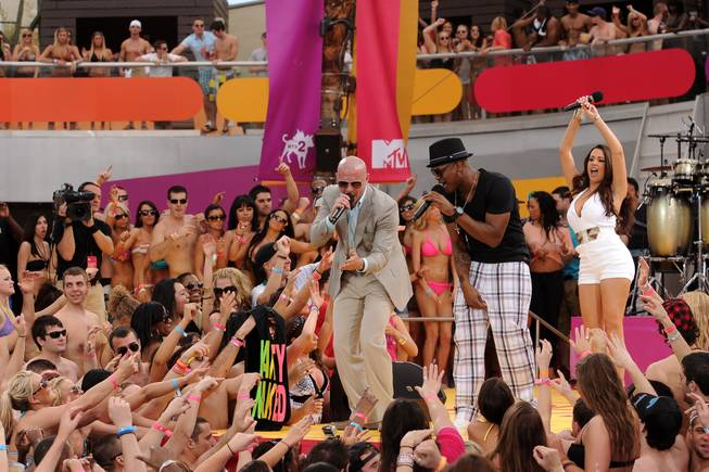Pitbull and Ne-Yo perform at the Palms pool during MTV's spring break party. The network has made the Palms its headquarters for spring break 2011.