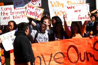 Students rally outside Chaparral High School on Wednesday, March 9, 2011, in protest of the district's plans to reorganize the school.
