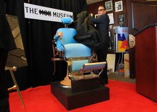 Artie Nash unveils the Mob Museum's most recent acquisition, the barber chair that Albert Anastasia was murdered in Wednesday, March 9, 2011.