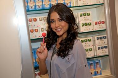 Arianny Celeste checks out Sugar Factory American Brasserie and poses with a signature Couture Pop.
