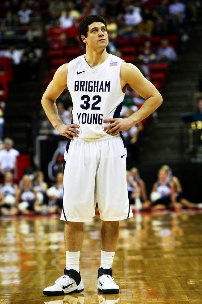 Jimmer Fredette of BYU reacts to an offensive foul during the quarterfinal game against TCU in the Mountain West Conference tournament Thursday, March 10, 2011.