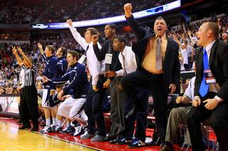 The BYU bench celebrates a successful three-point shot late in their Mountain West Conference Championship game against TCU Thursday, March 10, 2011 at the Thomas & Mack Center. BYU won the game 64-58.