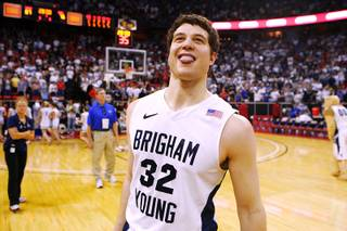 BYU guard Jimmer Fredette celebrates after defeating New Mexico 87-76 in their Mountain West Conference Championship game Friday, March 11, 2011 at the Thomas & Mack Center.